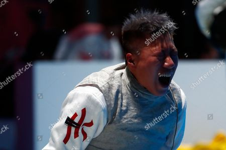 Liu Yan Wai of Hong Kong reacts after defeated Huo Xingxin of China in the Women's Foil Individual Quarterfinals during the Asian Games 2018 in Jakarta, Indonesia, 20 August 2018. The 18th Asian Games Jakarta-Palembang 2018 will take place from 18 August until 02 September 2018 in Jakarta and Palembang.