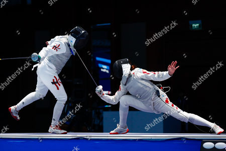 Liu Yan Wai of Hong Kong (L) competes against  Fu Yiting of China (R) in the Women's Foil Individual Semi-finals during the Asian Games 2018 in Jakarta, Indonesia, 20 August 2018. The 18th Asian Games Jakarta-Palembang 2018 will take place from 18 August until 02 September 2018 in Jakarta and Palembang.