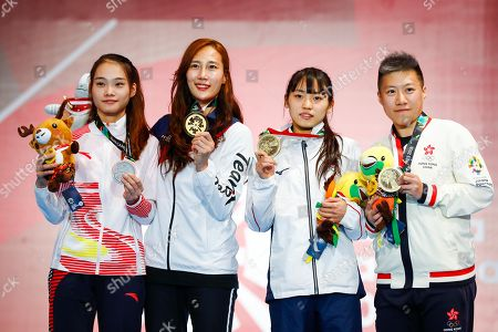 (L-R) Silver medalist Fu Yiting of China, Gold medalist Jeon Hee Sook of South Korea , Bronze medalists Azuma Sera of Japan and Liu Yan Wai of Hong Kong pose for photographs in the awarding ceremony of the Women's Foil Individual Finals during the Asian Games 2018 in Jakarta, Indonesia, 20 August 2018.