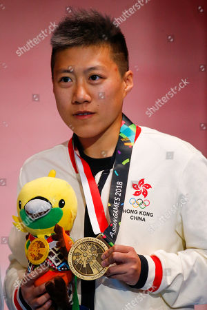 Bronze medalist Liu Yan Wai of Hong Kong poses for photographs in the awarding ceremony of the Women's Foil Individual Finals during the Asian Games 2018 in Jakarta, Indonesia, 20 August 2018.