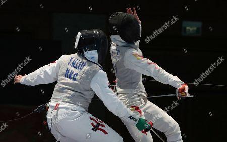 Yan Wai Liu, Yiting Fu. Hong Kong's Yan Wai Liu, left, competes against China's Yiting Fu, right, during their women foil individual fencing match at the 18th Asian Games in Jakarta, Indonesia