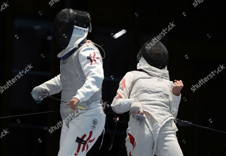 Yan Wai Liu, Yiting Fu. China's Yiting Fu, right, celebrates after scoring a point agains Hong Kong's Yan Wai Liu, left, during their women foil individual fencing match at the 18th Asian Games in Jakarta, Indonesia