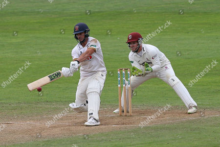 Ryan ten Doeschate of Essex hits out as Steven Davies looks on from behind the stumps during Somerset CCC vs Essex CCC, Specsavers County Championship Division 1 Cricket at The Cooper Associates County Ground on 20th August 2018