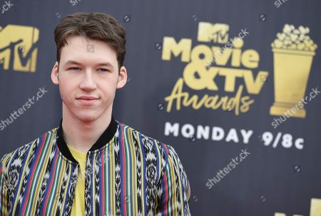 Devin Druid arrives at the MTV Movie and TV Awards at the Barker Hangar, in Santa Monica, Calif