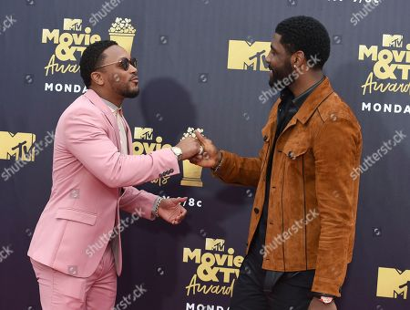 Romeo Miller, left, and Kyrie Irving arrive at the MTV Movie and TV Awards at the Barker Hangar, in Santa Monica, Calif