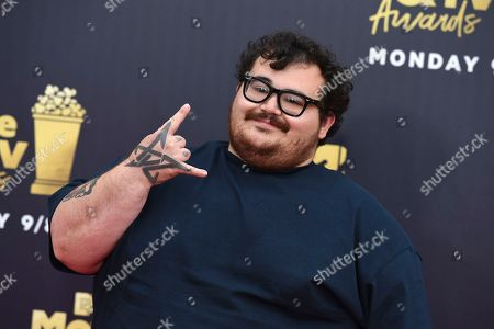 Jon Gabrus arrives at the MTV Movie and TV Awards at the Barker Hangar, in Santa Monica, Calif