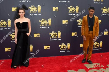 Katherine Langford, left, and Steven Silver arrive at the MTV Movie and TV Awards at the Barker Hangar, in Santa Monica, Calif