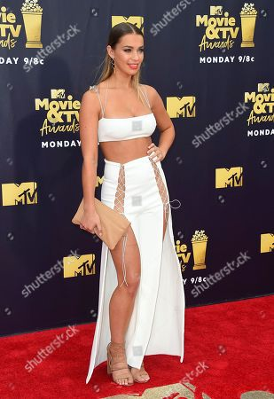 Liv Pollock arrives at the MTV Movie and TV Awards at the Barker Hangar, in Santa Monica, Calif