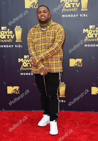 DJ Mustard arrives at the MTV Movie and TV Awards at the Barker Hangar, in Santa Monica, Calif