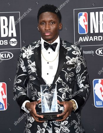 Victor Oladipo, of the Indiana Pacers, poses in the press room with the most improved player award at the NBA Awards, at the Barker Hangar in Santa Monica, Calif
