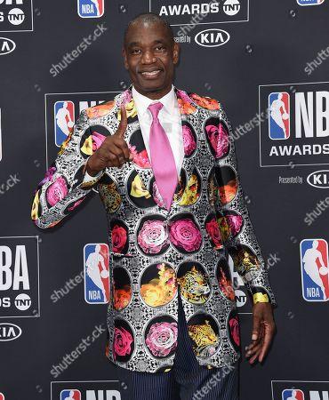 Dikembe Mutombo poses in the press room wearing his Sager Strong Award sport coat at the NBA Awards, at the Barker Hangar in Santa Monica, Calif