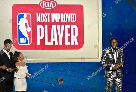 Victor Oladipo, of the Indiana Pacers, accepts the most improved player award at the NBA Awards, at the Barker Hangar in Santa Monica, Calif. Looking on from left are presents Josh Duhamel and Adrienne Houghton