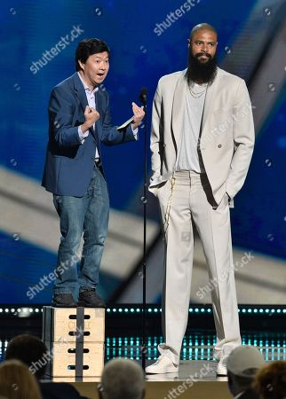 Ken Jeong, left, and Tyson Chandler, of the Phoenix Suns, present the defensive player of the year award at the NBA Awards, at the Barker Hangar in Santa Monica, Calif