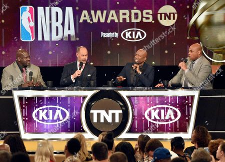 Shaquille O'Neal, from left, Ernie Johnson, Kenny Smith and Charles Barkley speak at the NBA Awards, at the Barker Hangar in Santa Monica, Calif