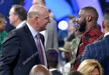 Steve Ballmer, owner of the Los Angeles Clippers, left, speaks with NBA player Chris Paul, of the Houston Rockets, in the audience at the NBA Awards, at the Barker Hangar in Santa Monica, Calif