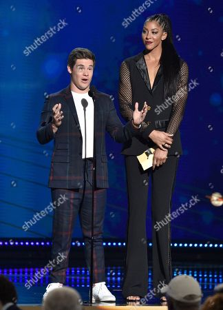 Adam Devine, left, and WNBA player Candace Parker, of the Los Angeles Sparks, present the coach of the year award at the NBA Awards, at the Barker Hangar in Santa Monica, Calif