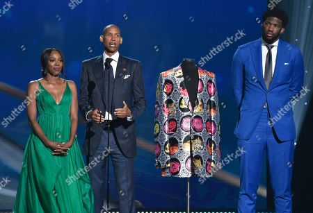 Yvonne Orji, from left, Reggie Miller and NBA player Joel Embiid, of the Philadelphia 76ers, present the Sager Strong award at the NBA Awards, at the Barker Hangar in Santa Monica, Calif