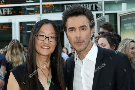 "Jennifer Yuh Nelson, left, and Shawn Levy arrive at the LA Premiere of ""The Darkest Minds"" at the Arclight Hollywood, in Los Angeles"
