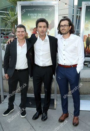 "Dan Levine, from left, Shawn Levy and Dan Cohen arrive at the LA Premiere of ""The Darkest Minds"" at the Arclight Hollywood, in Los Angeles"