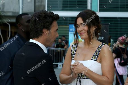 "Mandy Moore, right, talks to Shawn Levy as she arrives at the LA Premiere of ""The Darkest Minds"" at the Arclight Hollywood, in Los Angeles"