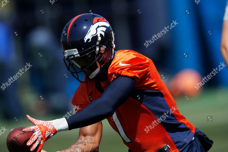 Denver Broncos punter Marquette King (1) takes part in drills during practice at the NFL football team's headquarters, in Englewood, Colo