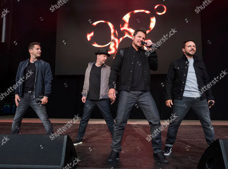 98 Degrees band members, from left, Jeff Timmons, Justin Jeffre, Nick Lachey and Drew Lachey perform at KTUphoria 2018 at Jones Beach Theater, in Wantagh, New York