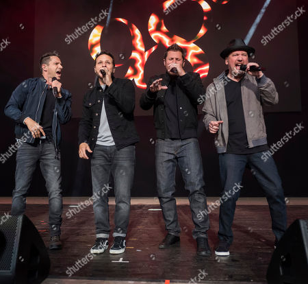 Stock Picture of 98 Degrees band members, from left, Jeff Timmons, Drew Lachey, Nick Lachey and Justin Jeffre perform at KTUphoria 2018 at Jones Beach Theater, in Wantagh, New York