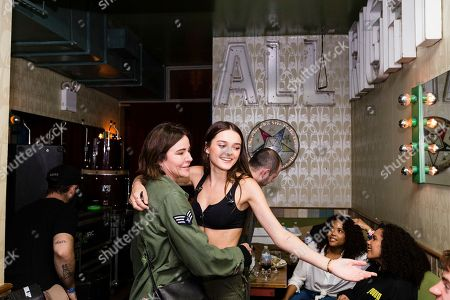 Stock Image of Christa Miller, left, and Charlotte Lawrence are seen backstage at Baby's All Right, in NY, NY
