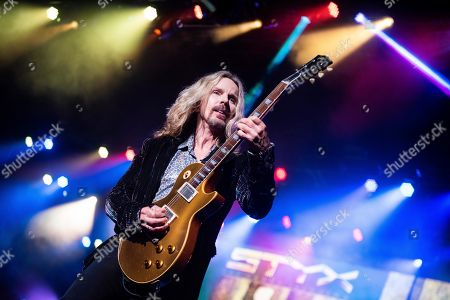 Tommy Shaw, of Styx, performs on stage at Verizon Wireless Amphitheater on Saturday, June,18, 2018, in Alpharetta, GA