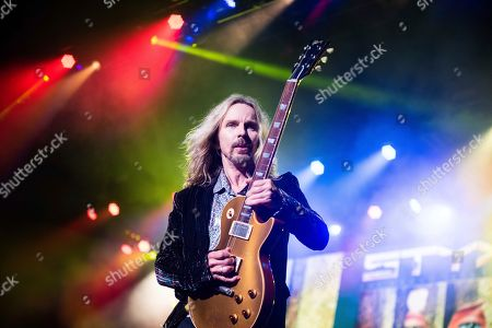 Tommy Shaw, of Styx, performs on stage at Verizon Wireless Amphitheater, in Alpharetta, Ga