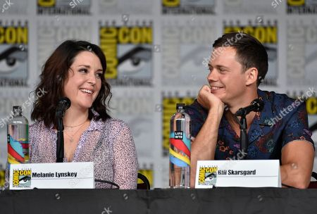 """Melanie Lynskey, left, and Bill Skarsgard attend a panel discussion following the world premiere of """"Castle Rock"""" on day two of Comic-Con International, in San Diego"""