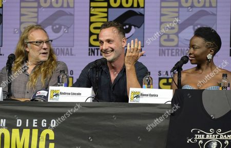 """Greg Nicotero, from left, Andrew Lincoln and Danai Gurira attend a panel for """"The Walking Dead"""" on day two of Comic-Con International, in San Diego"""