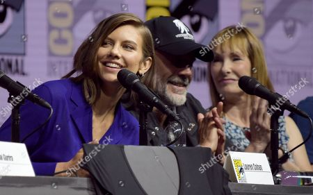 """Lauren Cohan, from left, Jeffrey Dean Morgan and producer Gale Anne Hurd attend a panel for """"The Walking Dead"""" on day two of Comic-Con International, in San Diego"""