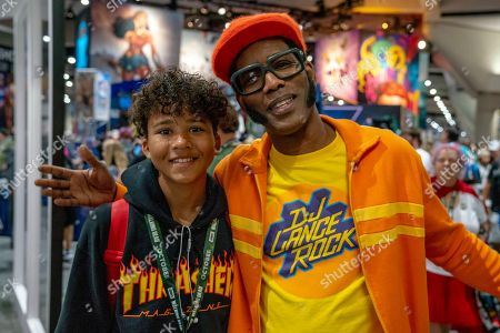 "DJ Lance Rock"", Lance Robertson, of ""Yo Gabba Gabba"", poses with Hayden Brotschi of San Diego, CA on day two of Comic-Con International on in San Diego, CA"