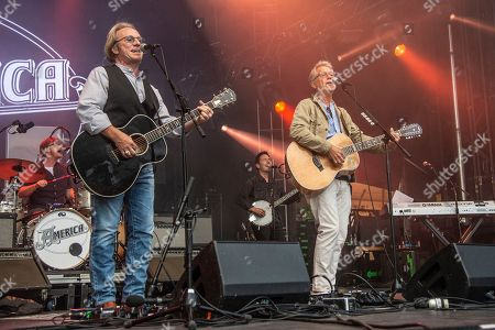 Dewey Bunnell, left, and Gerry Beckley of America perform during the Festival d'ete de Quebec, in Quebec City, Canada
