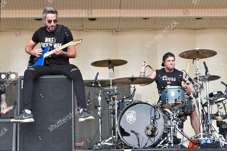 Stock Image of Zack Merrick (left) (Editor's Note - obscene language on shirt) and Robert Rian Dawson of the band All Time Low performs on day one at Lollapalooza in Grant Park on in Chicago