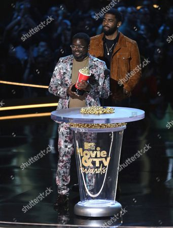 Lil Rel Howery, left, and Kyrie Irving present the most frightened performance award at the MTV Movie and TV Awards at the Barker Hangar, in Santa Monica, Calif