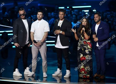 """Mike """"The Situation"""" Sorrentino, from left, Vinny Guadagnino, Paul """"DJ Pauly D"""" DelVecchio, Deena Nicole and Ronnie Ortiz-Magro, from the cast of """"Jersey Shore,"""" present the best on-screen team at the MTV Movie and TV Awards at the Barker Hangar, in Santa Monica, Calif"""