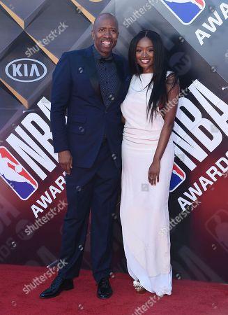 Kenny Smith, left, and Kayla Brianna arrive at the NBA Awards, at the Barker Hangar in Santa Monica, Calif