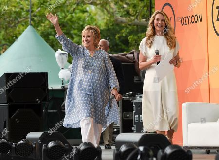 Former First Lady of The United States, Democratic presidential candidate and former Secretary of State Hillary Rodham Clinton, left, arrives for a conversation with Laurene Powell Jobs at OZY Fest in Central Park, in New York