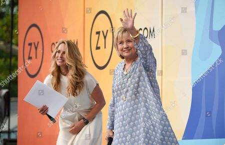 Stock Photo of Democratic presidential candidate and former Secretary of State Hillary Rodham Clinton, right, waves to the crowd before a conversation with Laurene Powell Jobs at OZY Fest in Central Park, in New York