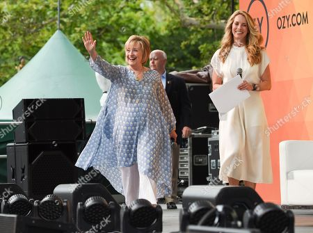Stock Image of Former First Lady of The United States, Democratic presidential candidate and former Secretary of State Hillary Rodham Clinton, left, arrives for a conversation with Laurene Powell Jobs at OZY Fest in Central Park, in New York