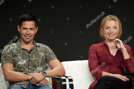 """Jay Hernandez, left, and Perdita Weeks participate in the """"Magnum P.I."""" panel during the Television Critics Association Summer Press Tour at the the Beverly Hilton Hotel, in Beverly Hills, Calif"""