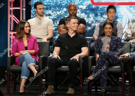 "Ryan Guzman, from back row left, Rockmond Dunbar and Kenneth Choi, and from front row left, Jennifer Love Hewitt, Peter Krause and actress/co-executive producer Angela Bassett participate in the ""9-1-1"" panel during the Fox Television Critics Association Summer Press Tour at The Beverly Hilton hotel, in Beverly Hills, Calif"
