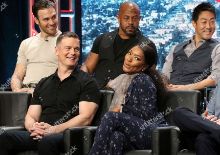 "Ryan Guzman, from back row left, Rockmond Dunbar, Kenneth Choi, and from front row left, Peter Krause and actress/co-executive producer Angela Bassett participate in the ""9-1-1"" panel during the Fox Television Critics Association Summer Press Tour at The Beverly Hilton hotel, in Beverly Hills, Calif"