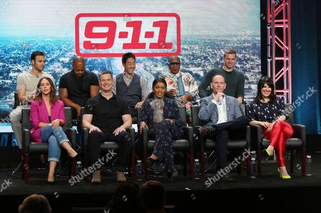 "Ryan Guzman, from back row left, Rockmond Dunbar, Kenneth Choi, Aisha Hinds, Oliver Stark, and from front row left, Jennifer Love Hewitt, Peter Krause, actress/co-executive producer Angela Bassett, co-creator/executive producer/writer Tim Minear and executive producer Alexis Martin Woodall participate in the ""9-1-1"" panel during the Fox Television Critics Association Summer Press Tour at The Beverly Hilton hotel, in Beverly Hills, Calif"