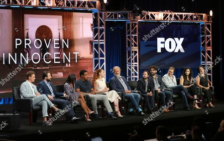 """Riley Smith, from left, Vincent Kartheiser, Nikki M. James, Russell Hornsby, Rachelle Lefevre, Kelsey Grammer, executive producer Danny Strong, creator/executive producer David Elliot, executive producer/showrunner Adam Armus, executive producer Stacy Greenberg and director Patricia Riggen participate in the """"Proven Innocent"""" panel during the Fox Television Critics Association Summer Press Tour at The Beverly Hilton hotel, in Beverly Hills, Calif"""