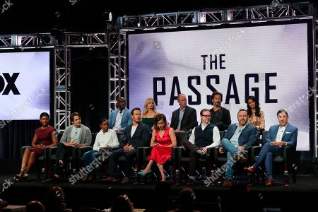 """McKinley Belcher, from back row left, Brianne Howey, Jamie McShane, Henry Ian Cusick, Emmanuelle Chriqui, and from front row left, Caroline Chikezie, Vincent Piazza, Saniyya Sidney, Mark-Paul Gosselaar, executive producer/showrunner/writer Liz Heldens, executive producer Matt Reeves, executive producer/director Jason Ensler and author Justin Cronin participate in """"The Passage"""" panel during the Fox Television Critics Association Summer Press Tour at The Beverly Hilton hotel, in Beverly Hills, Calif"""