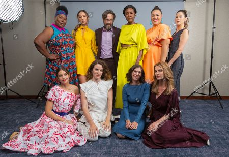 """Kia Stevens, from left, Alison Brie, Britt Baron, Liz Flahive, Marc Maron, Sydelle Noel, Carly Mensch, Britney Young, Betty Gilpin and Jackie Tohn, cast members and showrunners of the Netflix series """"Glow"""" pose for a photo during the Netflix portrait session at Television Critics Association Summer Press Tour at The Beverly Hilton hotel, in Beverly Hills, Calif"""