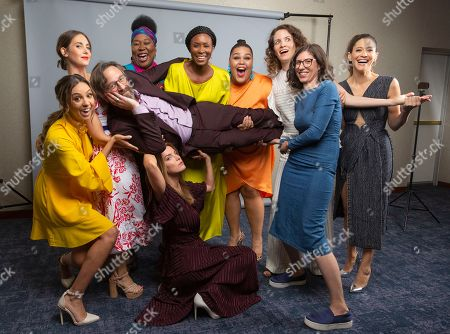 """Britt Baron, from left, Alison Brie, Kia Stevens, Sydelle Noel, Britney Young, Liz Flahive, Carly Mensch, Betty Gilpin, Jackie Tohn and Marc Maron, cast members and showrunners of the Netflix series """"Glow,"""" pose for a photo during the Netflix portrait session at Television Critics Association Summer Press Tour at The Beverly Hilton hotel, in Beverly Hills, Calif"""